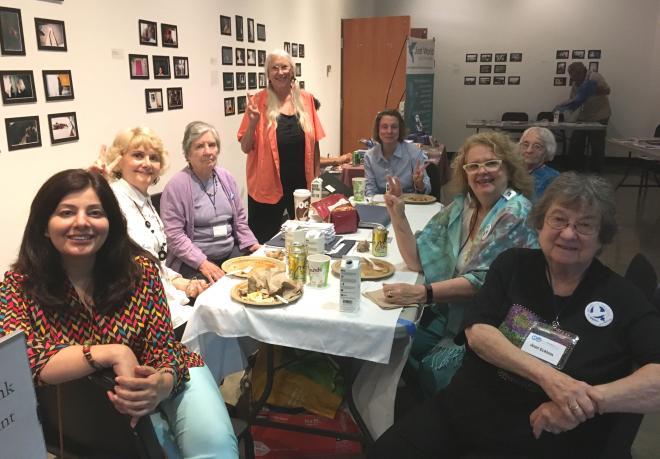 WILPF members meet at WILPF's literature table